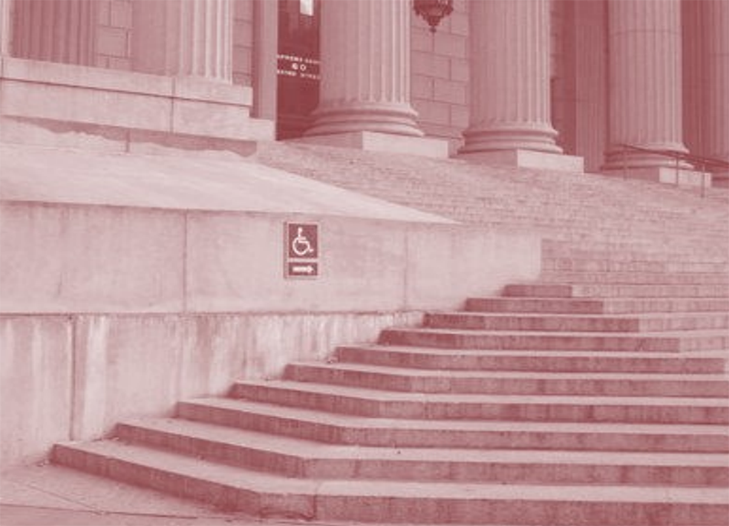Courthouse steps with wheelchair sign