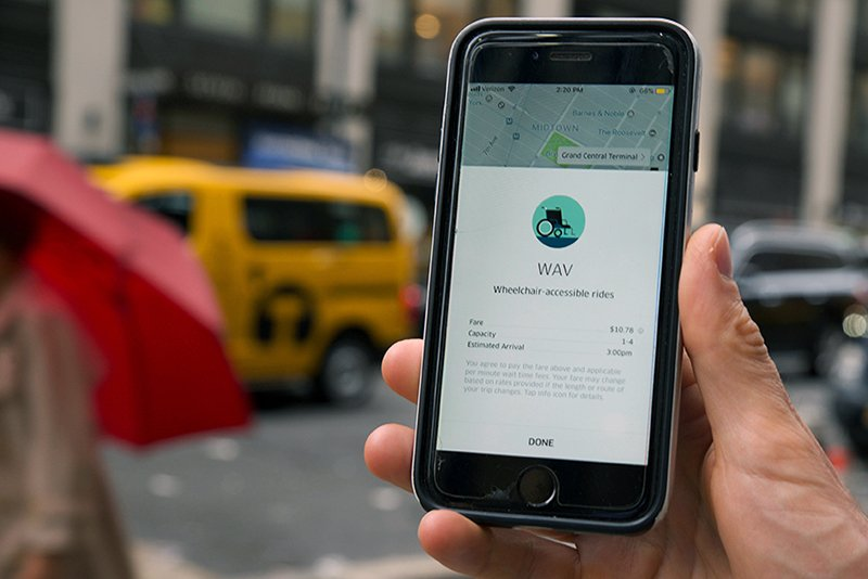 Image of a cell phone being used to hail an accessible for-hire-vehicle ride in New York