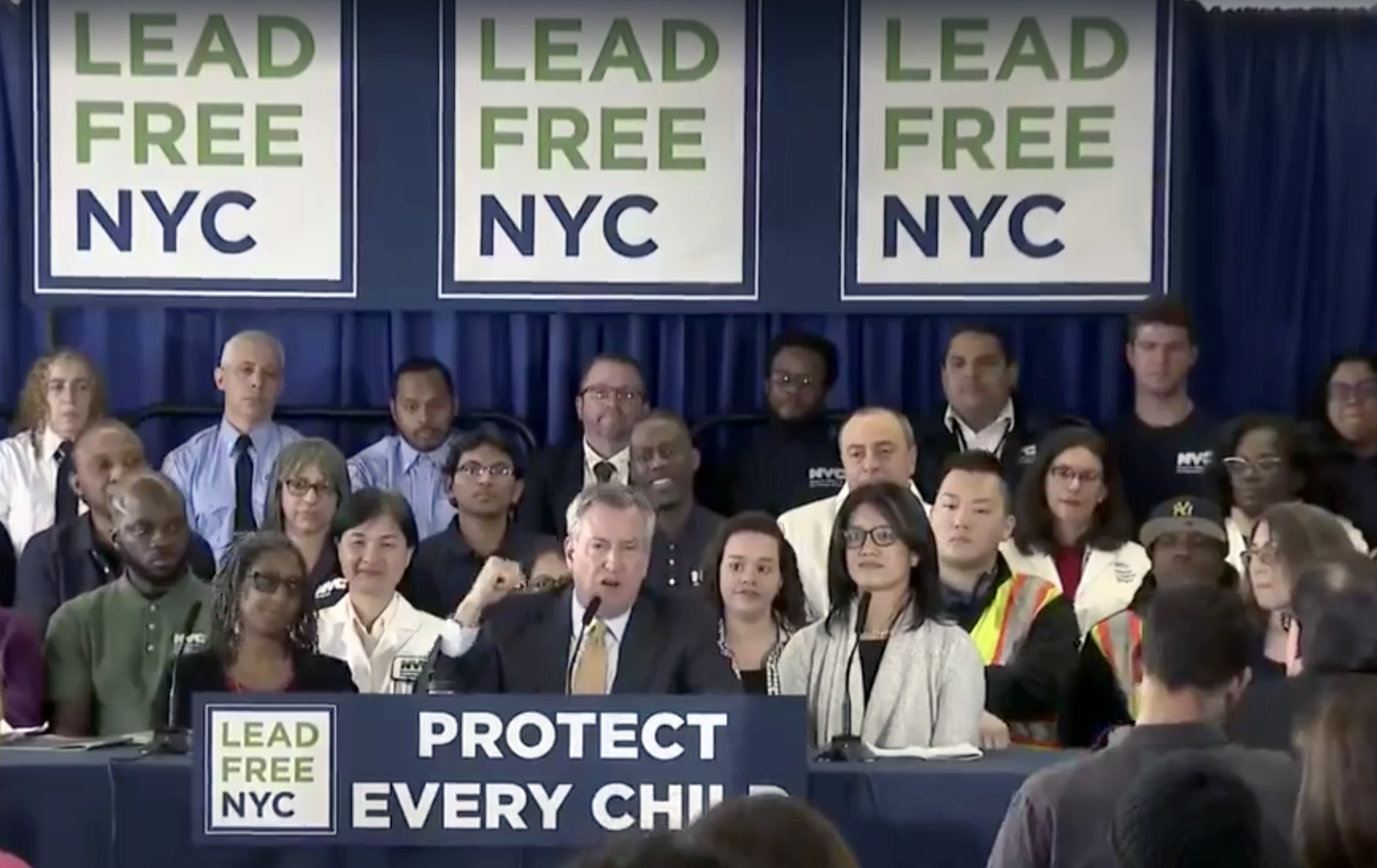 """Mayor De Blasio announces """"Lead Free NYC"""" plan, with NYLPI Director of Environmental Justice Rachel Spector (right) speaking"""